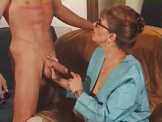 Cougar in Glasses and Fishnets Fucks
